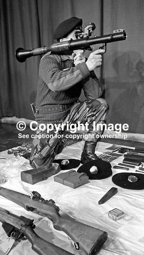 British Army officer demonstrates a Russian RPG7 rocket launcher, part of an arms haul uncovered by 1 Bn Queen's Regiment in the New Lodge district of Belfast, N Ireland, December 1972. 197212090779a.<br />