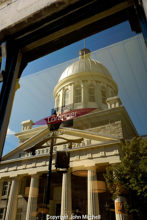 Reflection of the Marche Bonsecours market in a restaurant window in Old Montreal, Quebec, Canada