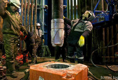 Workers drill with a diamond-studded drill head at the Achimgaz gas drilling well in Novy Urengoi, Siberia, Russia.