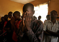 Youths take part in a religious service in the 'City of Rest', a rudimentary counselling and mini rehabilitation centre for recovering drug addicts, alcoholics and traumatised or delinquent youths.  It is run by a pastor who attributes the centre's success to extensive rest, food and prayer.