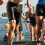 Swimmers try to get out as quickly as possible before retrieving their bicycles.