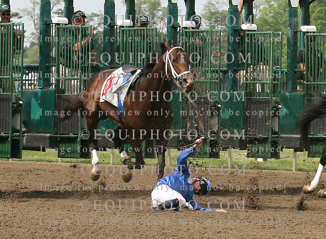 Jockey Garrett Gomezhist the ground after falling over the head of his mount Jadal #11 after the horse stumbled coming out of the gate in the 7th race at Monmouth Park in Oceanport, N.J. on Saturday May 22, 2010.  Gomez was taken to the hospital for observation.  Photo By Bill Denver/EQUI-PHOTO