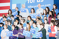 People watch from the stage as former Secretary of State and Democratic presidential candidate Hillary Rodham Clinton speaks at a rally at Nashua Community College in Nashua, New Hampshire, on Tues. Feb. 2, 2016. Former president Bill Clinton also spoke at the event. The day before, Hillary Clinton won the Iowa caucus by a small margin over Bernie Sanders.