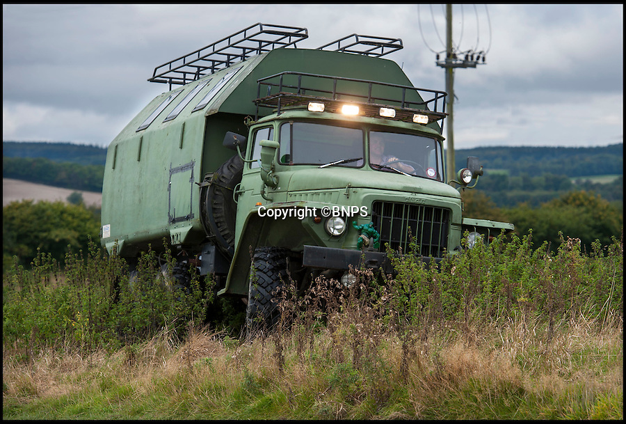 BNPS.co.uk (01202 558833)<br /> Pic: PhilYeomans/BNPS<br /> <br /> All terrain vehicle...<br /> <br /> Carry on campski...<br /> <br /> Madcap Chris Armstrong has turned a Cold War Russian army monster truck into the ultimate camper van.<br /> <br /> Chris, 41, has converted the back of the 12.5 ton six wheel drive into luxury accommodation that has a double bed, shower, toilet and its own kitchen with fridge.<br /> <br /> He turns heads whenever he roars onto a countryside campsite in the beast and has actually been banned from several parks because of the sheer size of his communist camper. <br /> <br /> He is now selling it on eBay with a reserve price of £21,000.