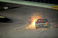 Nov. 14, 2008; Homestead, FL, USA; NASCAR Craftsman Truck Series driver Mike Skinner blows a tire as J.R. Fitzpatrick follows during the Ford 200 at Homestead Miami Speedway. Mandatory Credit: Mark J. Rebilas-