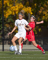Boston College midfielder Kristen Mewis (19) attempts to control the ball as Marist College midfielder/defender Jamie Strumwasser (3) pressures. Boston College defeated Marist College, 6-1, in NCAA tournament play at Newton Campus Field, November 13, 2011.