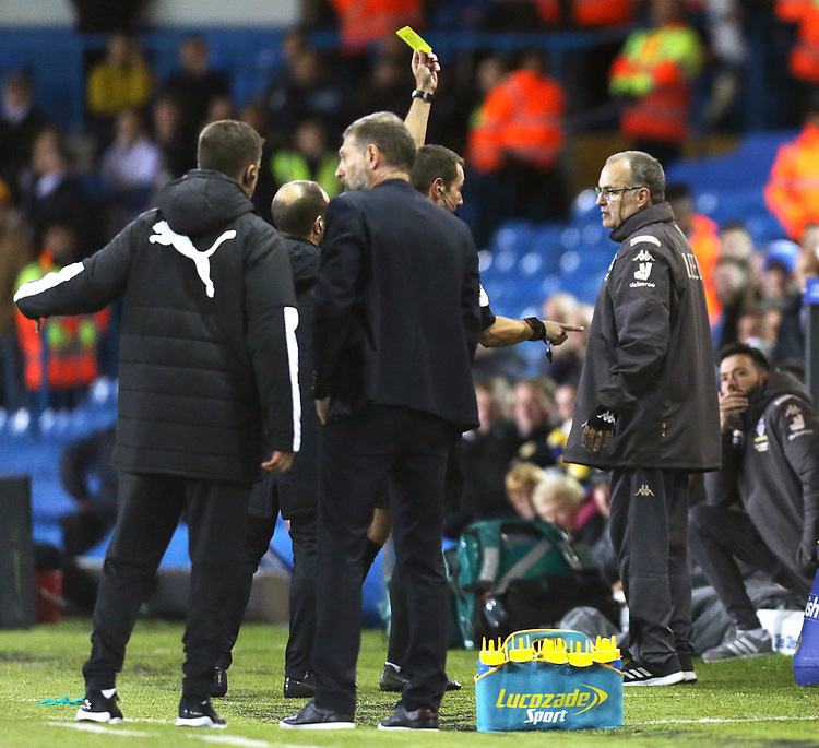 Leeds United manager Marcelo Bielsa is shown a yellow card by referee David Coote<br /> <br /> Photographer Rich Linley/CameraSport<br /> <br /> The EFL Sky Bet Championship - Tuesday 1st October 2019  - Leeds United v West Bromwich Albion - Elland Road - Leeds<br /> <br /> World Copyright © 2019 CameraSport. All rights reserved. 43 Linden Ave. Countesthorpe. Leicester. England. LE8 5PG - Tel: +44 (0) 116 277 4147 - admin@camerasport.com - www.camerasport.com