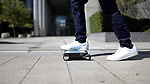 A 'portable car' the size of a 13-inch laptop is so light it can be carried in a backpack.  Japanese engineers have invented the slender WalkCar - weighing less than three bags of sugar - so commuters don't have to worry about public transport or finding a parking space ever again.<br /> <br /> The four-wheeled electric ride, which costs just under £1,500, reaches top speeds of almost 10 mph for distances just over three miles after 60 minutes of charging in 'sport' mode.  Taking it a slower pace of about 6 mph, users can travel for four miles on the electric transporter - which resembles a skateboard.  SEE OUR COPY FOR DETAILS.<br /> <br /> Please byline: Cocoa Motors./Solent News<br /> <br /> © Cocoa Motors./Solent News & Photo Agency<br /> UK +44 (0) 2380 458800