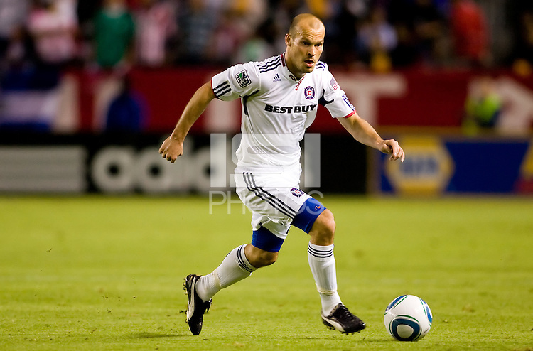Chicago Fire forward Freddie Ljungberg looking upfield for an open man dribbles with the ball. The Chicago Fire defeated CD Chivas USA 3-1 at Home Depot Center stadium in Carson, California on Saturday October 23, 2010.