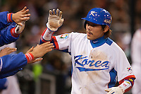 17 March 2009: #15 Yong Kyu Lee of Korea celebrates with teammates during the 2009 World Baseball Classic Pool 1 game 4 at Petco Park in San Diego, California, USA. Korea wins 4-1 over Japan.
