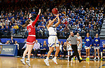 BROOKINGS, SD - FEBRUARY 22: Lindsey Theuninck #3 of the South Dakota State Jackrabbits lays the ball up past Chloe Lamb #22 of the South Dakota Coyotes Saturday at Frost Arena in Brookings, SD. (Photo by Dave Eggen/Inertia)