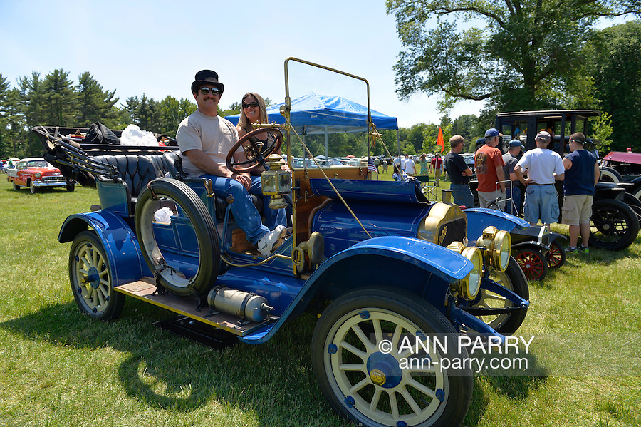 Old Westbury, New York. United States. 7th June 2015. SAM GRECO and LAURA GRECO, of Garden City Park, are sitting in their blue 1910 White at the 50th Annual Spring Meet Car Show sponsored by Greater New York Region Antique Automobile Club of America. Over 1,000 antique, classic, and custom cars participated at the popular Long Island vintage car show held at historic Old Westbury Gardens.