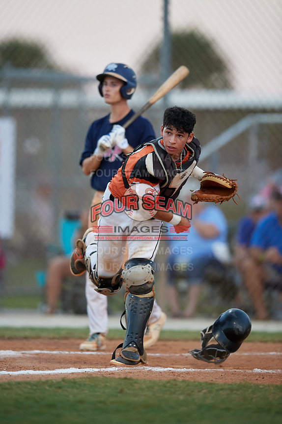 Braden Smith throws down to third base as Joe Marshall looks on during the WWBA World Championship at the Roger Dean Complex on October 20, 2018 in Jupiter, Florida.  Braden Smith is a catcher from Indian Trail, North Carolina who attends Carmel Christian School.  (Mike Janes/Four Seam Images)