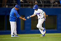 Florida Gators Brady McConnell (4) shakes hands with the third base coach after hitting a home run during a game against the Siena Saints on February 16, 2018 at Alfred A. McKethan Stadium in Gainesville, Florida.  Florida defeated Siena 7-1.  (Mike Janes/Four Seam Images)