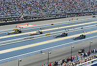 Apr. 14, 2012; Concord, NC, USA: NHRA top fuel dragster drivers (left to right) Spencer Massey , Clay Millican , Shawn Langdon and Hillary Will race four wide during qualifying for the Four Wide Nationals at zMax Dragway. Mandatory Credit: Mark J. Rebilas-