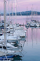 Sail boats docked in Talamone, Maremma district of Tuscany, Italy