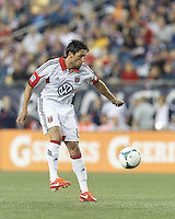 D.C. United midfielder John Thorrington (8) traps the ball. In a Major League Soccer (MLS) match, the New England Revolution (blue) tied D.C. United (white), 0-0, at Gillette Stadium on June 8, 2013.