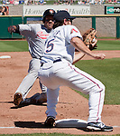 Sacramento River-Cats runner Michael Taylor is tagged out attempting to steal third base by Reno Aces third baseman Ryan Wheeler in their game played on Sunday afternoon, April 22, 2012 in Reno, Nevada.