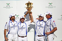 WELLINGTON, FL - MARCH 26: Valiente holds the winners trophy up high after winning the 2nd jewel of the Triple Crown in the 26 goal USPA Gold Cup Final, defeating Coca Cola 9-6, at the International Polo Club, Palm Beach on March 26, 2017 in Wellington, Florida. (Photo by Liz Lamont/Eclipse Sportswire/Getty Images)