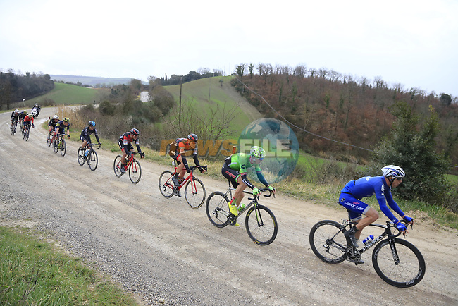 Group two on gravel sector 6 Pieve a Salti during the 2017 Strade Bianche running 175km from Siena to Siena, Tuscany, Italy 4th March 2017.<br /> Picture: Eoin Clarke | Newsfile<br /> <br /> <br /> All photos usage must carry mandatory copyright credit (&copy; Newsfile | Eoin Clarke)