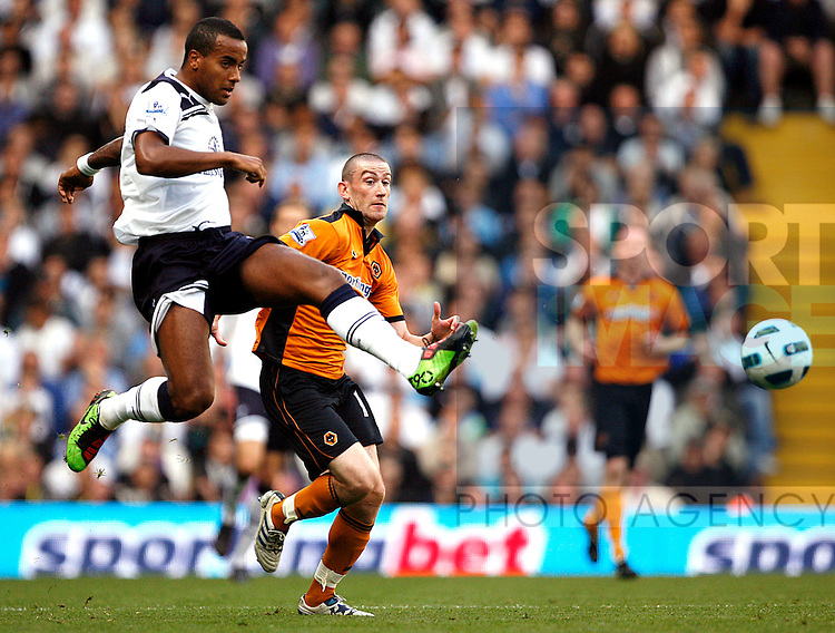 Tom Huddlestone of Tottenham Hotspur holds off David Jones of Wolverhampton Wanderers