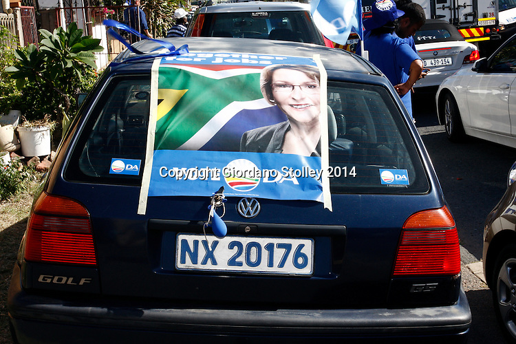 DURBAN - 5 April 2014 - A car in Durban's Wentworth area is adorned with a poster of Democratic Alliance leader Helen Zille who was campaigning in the Durban suburb, whose residents are predominantly colored (mixed race). Wentworth is known for its drugs and associated gang warfare. Picture: Allied Picture Press/ APP