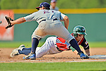 4 July 2012: Vermont Lake Monsters infielder Sam Roberts dives safely back to first during action against the Hudson Valley Renegades at Centennial Field in Burlington, Vermont. The Lake Monsters edged out the Renegades the Cyclones 2-1 in NY Penn League action. Mandatory Credit: Ed Wolfstein Photo