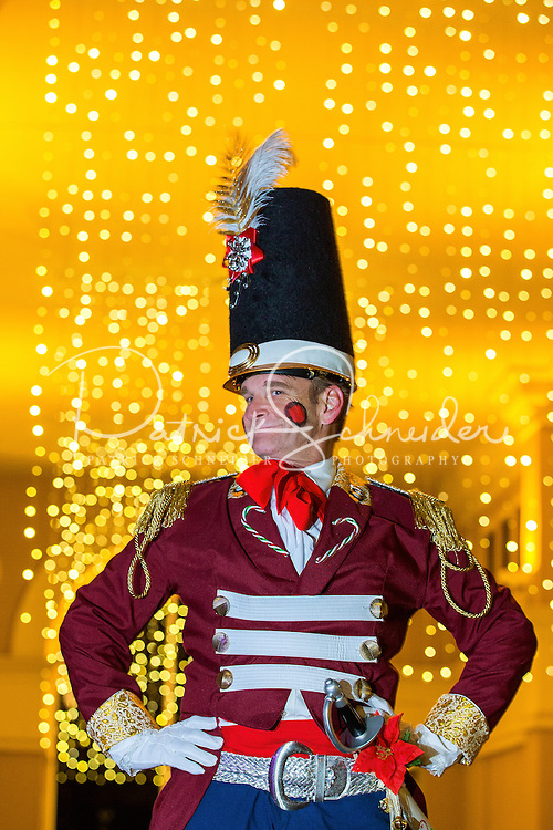 Charlotte Christmas Events - Photography of the Phillips Place Winter Wonderland Christmas event in Charlotte, North Carolina.<br /> <br /> A smiling stilt walker Christmas toy solider, entertaining the children at a Charlotte holiday event.<br /> <br /> Charlotte Photographer - PatrickSchneiderPhoto.com