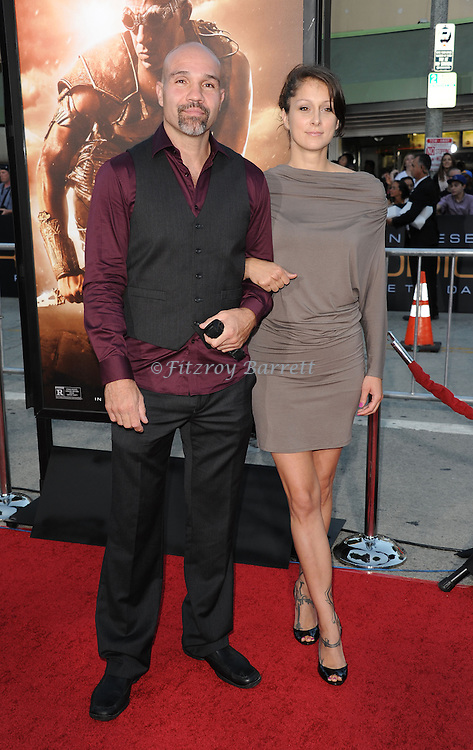 Conrad Pla and date at the RIDDICK World Premiere, held at the Regency Village Theater Los Angeles, Ca. August 28, 2013