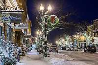 Water Street in Excelsior Minnesota on a snowy night during the holidays.