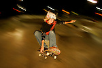 Skateboarder Mark Clements, 15, of Hampstead, North Carolina, does in indie grab while getting some big air coming out of the bowl at the Rock during a night session at Camp Woodward in Woodward, Pennsylvania.  August 9, 2005.