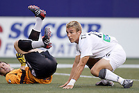 The MetroStars' goalkeeper Jonny Walker and the Revolution's Taylor Twellman watch Twellman's header find the back of the net to put the Revolution up 2-0 in the 14th minute.The New England Revolution were defeated by the MetroStars 3 to 2 on Saturday September 11, 2004 at Giant's Stadium, East Rutherford, NJ..