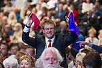 © Joel Goodman - 07973 332324 . 22/09/2013 . Brighton , UK . A man in the audience waves red and blue cloths in a bid to be called to address the audience during a session this afternoon (Sunday 22nd September 2013) . Day 1 of the Labour Party 's annual conference in Brighton . Photo credit : Joel Goodman