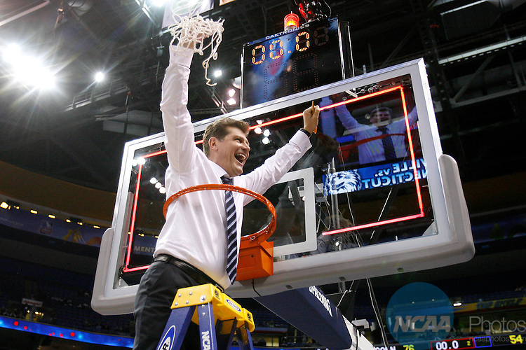 07 APR 2009:  The University of Connecticut Women's Basketball Head Coach Geno Auriemma cuts down the net after the Huskies defeated the University of Louisville in the Division I Women's Basketball Championship held at the Scottrade Center in St. Louis, MO.  Connecticut defeated Louisville 76-54 to take home the National Title.  Trevor Brown, Jr./NCAA Photos