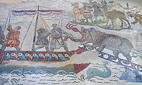 Ambulatory of the Great Hunt Roman mosaic, elephant is loaded onto a ship, room no 28, at the Villa Romana del Casale, first quarter of the 4th century AD. Sicily, Italy. A UNESCO World Heritage Site.<br /> <br /> The Great Hunt ambulatory is around 60 meters long (200 Roman feet) and connects the master's northern apartments with the triclinium in the south. The door in the centre of the the Great Hunt ambulatory leads to audience hall. <br /> <br /> The Great Hunt Roman mosaic depicts African animals being hunted and put onto ships to be taken to the Colosseum.
