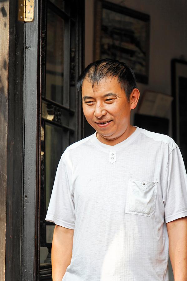 Chinese man in doorway, Beijing, China, Asia