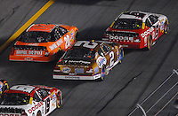 Feb 10, 2007; Daytona, FL, USA; Nascar Nextel Cup driver Kasey Kahne (9) leads Tony Stewart (20) and Kurt Busch (2) during the Budweiser Shootout at Daytona International Speedway. Mandatory Credit: Mark J. Rebilas