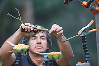Photographer Yamil Saenz arranges a bird feeder at San Jorge Eco-Lodge, Quito, Ecuador