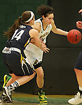 JANUARY 6, 2015 -- Dakota Barrie #32 of Black Hills State tries to get around the defensive pressure of Jordan Needens #14 of South Dakota Mines during their college women's basketball game Tuesday evening at the Donald E. Young Center in Spearfish, S.D. At right is Mackenzie Kenney #40 of South Dakota Mines.  (Photo by Dick Carlson/Inertia)