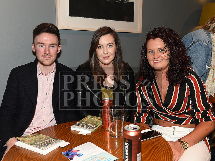 Marty Magill, Laura Curran and Laura Bailey at the launch of Ciarán Hodgers book Cosmocartography in The Droichead Arts Centre. Photo:Colin Bell/pressphotos.ie
