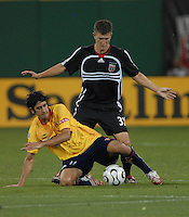 Monarcas Morelia midfielder Gonzalo Choy (11)  goes down defending the ball while covered by DC  United defender Bobby Boswell (32). Monarcas Morelia tied DC United 1-1 in  the SuperLiga opening match of the group B, at RFK Stadium Washington DC, Wednesday July 26, 2007.