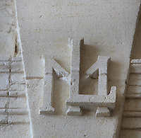 Sculptural detail of initials LM, for Louis XIV and Queen Marie-Therese, in the King's Apartments on the first floor of the Phare de Cordouan or Cordouan Lighthouse, built 1584-1611 in Renaissance style by Louis de Foix, 1530-1604, French architect, located 7km at sea, near the mouth of the Gironde estuary, Aquitaine, France. This is the oldest lighthouse in France. There are 4 storeys, with keeper apartments and an entrance hall, King's apartments, chapel, secondary lantern and the lantern at the top at 68m. Parabolic lamps and lenses were added in the 18th and 19th centuries. The lighthouse is listed as a historic monument. Picture by Manuel Cohen