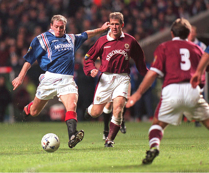Paul Gascoigne scores in the Coca Cola Cup Final past Hearts players Gary Mackay and Neil Pointon