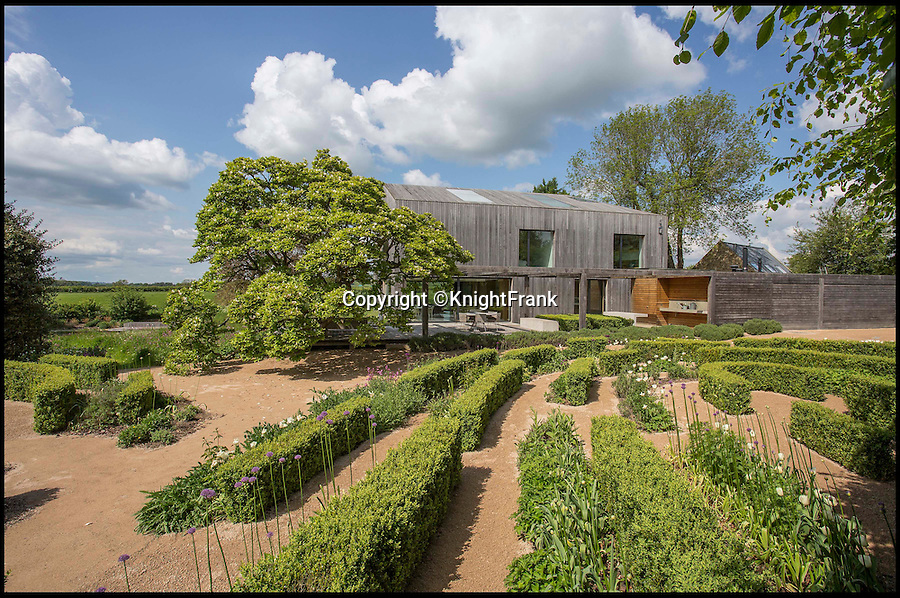 BNPS.co.uk (01202 558833)<br /> Pic: KnightFrank/BNPS<br /> <br /> Escape the rat race...<br /> <br /> Homebuyers can get back to nature in style with this stunning modern barn which comes with its own natural swimming pond.<br /> <br /> From the outside Far End has been cleverly designed to blend into its natural surroundings but inside the £2.95million house is anything but basic.<br /> <br /> The house sits on the edge of Kingham, a village on the Gloucestershire/Oxfordshire borders, and has incredible views of the surrounding Cotswold countryside.