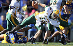 BROOKINGS, SD - SEPTEMBER 28:   Jack Sherlock #36 from South Dakota State University trips up Brock Jensen #16 from North Dakota State University in the third quarter of their game Saturday afternoon at Coughlin Alumni Stadium in Brookings. (Photo by Dave Eggen/Inertia)