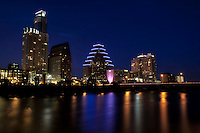 The lights of the Austin Skyline cast a colorful reflection on Town Lake in downtown Austin, Texas, USA