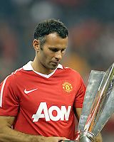 Ryan Giggs #11 of Manchester United with the MVP trophy during the 2010 MLS All-Star match at Reliant Stadium, on July 28 2010, in Houston, Texas. Manchester United won 5-2.