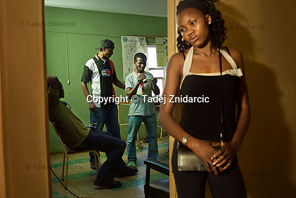 Young film actress Ogbor Josephine Mena (right) waits for a scene in which she will act, while members of the film crew check what had been recorded earlier on the set of a Nollywood movie production. Nollywood has become the second largest employer in Nigeria and many young people now see the movie industry as their ticket to success in a country that offers few other opportunities.