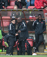 former Leyton Orients U16s Manager Frederico Morias (left) talks to Hackney garage owner Errol McKellar after the first team manager is sent off at HT during the Sky Bet League 2 match between Leyton Orient and Wycombe Wanderers at the Matchroom Stadium, London, England on 1 April 2017. Photo by Andy Rowland.
