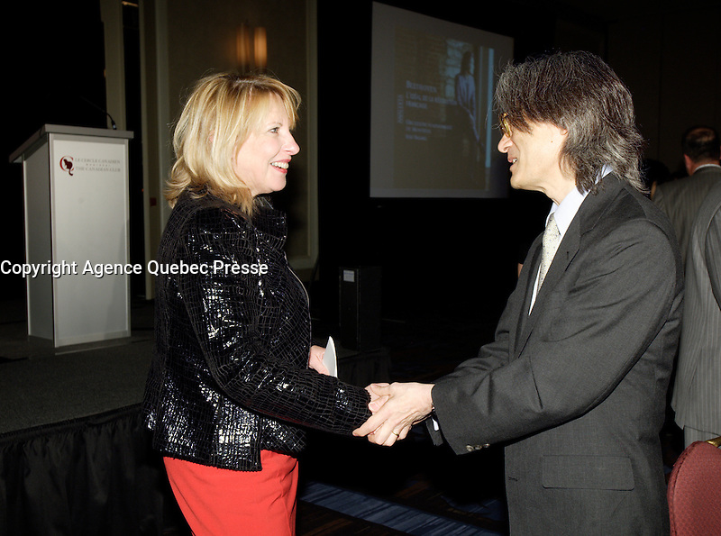 October 30 2011 - Montreal (Qc) CANADA -Christine Saint-Pierre, Quebec Cultural Affairs Minister (L) greet Kent Nagano  after he adressed the Canadian Club of Montreal